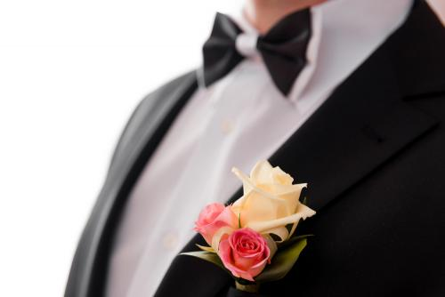 Boutonniere and bowtie close up.