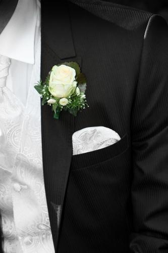 Groom with formalwear and flower on lapel
