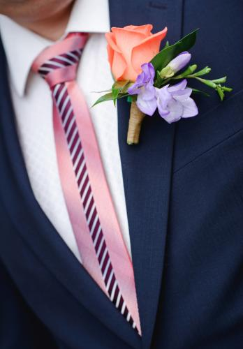 groom with flowers